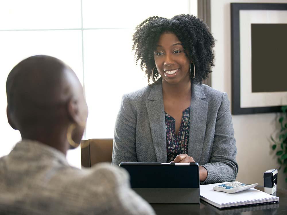 Women as desk talking to customer